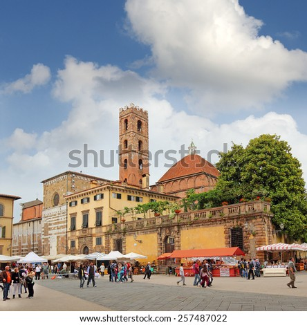 LUCCA, ITALY - MAY 18: Square San Martino (Piazza San Martino) in Lucca on May 18, 2013. Lucca is one of the most beautiful cities in Tuscany - stock photo