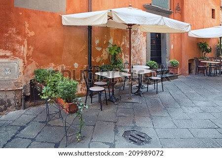 Lucca - outdoor dining nook in Tuscany, Italy - stock photo