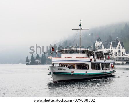 LUCERNE, SWITZERLAND - DEC 30, 2015: Passenger boat in Lake Lucerne. The lake is  the fourth largest in the country which has a total area of 114 km² at an elevation of 434 m above sea level.