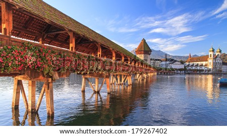 Lucerne, Switzerland, early morning. The Chapel Bridge and the Jesuit Church.