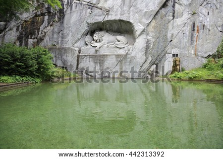 LUCERNE, SWITZERLAND - JUNE 1, 2016: Dying Lion. The world famous sculpture composition in the rock - stock photo