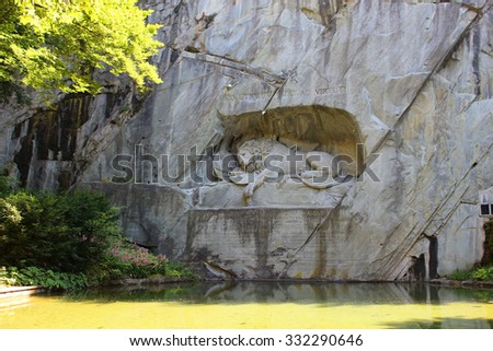 Lucerne, Switzerland, June, 28, 2015: The dying lion statue called Lowendenkmal , a monument to the Swiss Guards of Louis XVI of France, in Lucerne Switzerland - stock photo