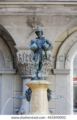 LUCERNE, SWITZERLAND - MAY 08, 2016: Goose Man fountain that is replica of famous Goose man of Nuremberg that were made in many copies and can be meet in many other places