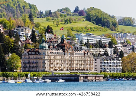 LUCERNE, SWITZERLAND - MAY 05, 2016: Palace Luzern it is is a 5-star hotel facing to Lake Lucerne was built in 1906. Nowadays the hotel offers 129 rooms and suites in the Belle Epoque style - stock photo