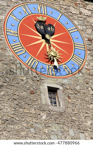LUCERNE, SWITZERLAND - MAY 08, 2016: The big tower clock of Town Hall that was built in the early 1600s. The Clock Tower height it is over 40 meters.