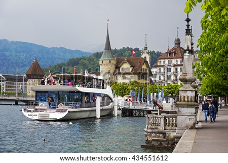 LUCERNE, SWITZERLAND - MAY 03, 2016: The city seen from the Lake Lucerne. At the ferry terminal MS Saphir is moored. It is elegant Panorama-Yacht that offers breathtaking tours of the lake - stock photo