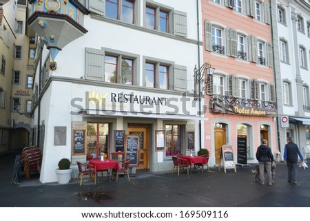 LUCERNE, SWITZERLAND - NOVEMBER 5, 2013: View of cafe in center of Lucerne. Lucerne - the city in the heart of the Swiss plateau, the capital of the eponymous German-speaking canton of Lucerne.