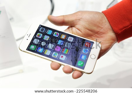 Lucerne Switzerland - OCTOBER 21: Custormer holds an iPhone 6 Plus at the Apple Store in Lucerne Switzerland on October 21, 2014. Apple releases the new iPhone 6 and iPhone 6 Plus on September , 2014. - stock photo