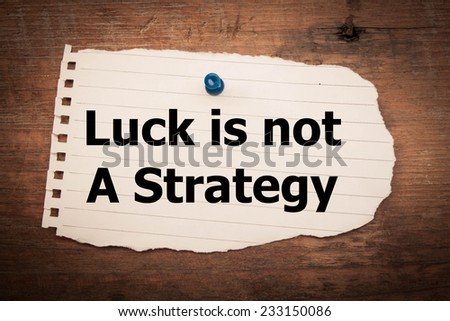 Luck is not a strategy  text on wood background  - stock photo