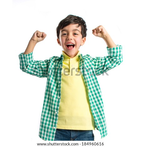 Lucky brunette kid over isolated white background  - stock photo