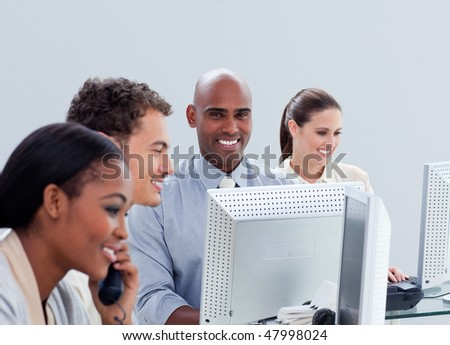 Lucky business group working hard in the office in a company - stock photo