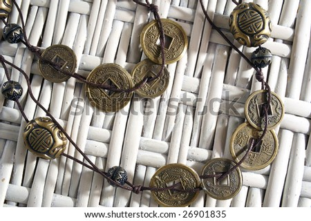 Lucky coins on the cane background - stock photo