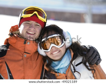 Lucky couple  snowboarders  in a mountain - stock photo