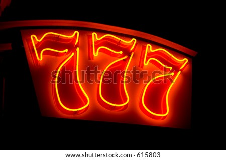 lucky figures 777 - neon sign - stock photo