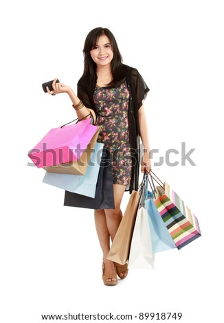 Lucky shopping girl with phone. Isolated on white background