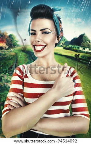 lucky smiling shepherdess on country view - stock photo