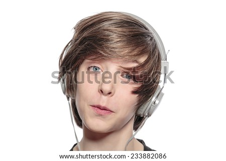 lucky teenage boy with headphones, isolated on white - stock photo