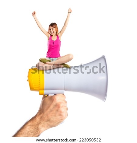 Lucky woman sitting on megaphone - stock photo