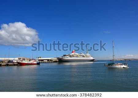 LUDERITZ, NAMIBIA - JAN 27, 2016: Big cruise ship Fred Olson cruise lines Boudicca shown in the port of Luderitz. Luderitz is popular destination for a many of cruise lines