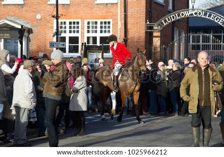 LUDLOW, UK - DECEMBER 26: Riders taking part in the annual Boxing Day hunt leave the grounds of Ludlow castle to pass through the attendant crowd & start the days sport on December 26, 2016 in Ludlow