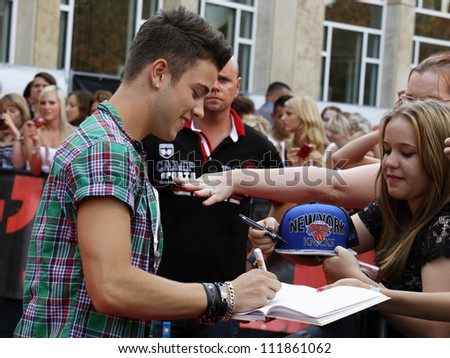 LUDWIGSBURG - AUGUST 29: Musician Luca Haenni, many national and international superstars from the music scene in the Forum Theatre celebrated in Ludwigsburg, Germany. August 29, 2012. - stock photo