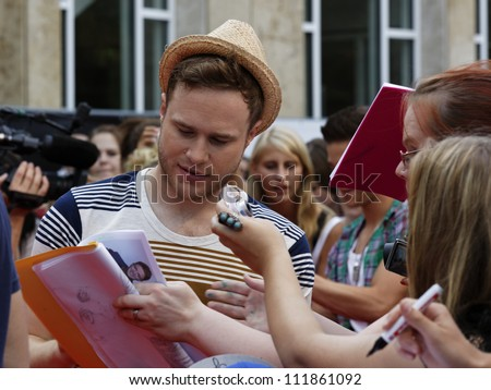 LUDWIGSBURG - AUGUST 29: Musician Olly Murs, many national and international superstars from the music scene in the Forum Theatre celebrated in Ludwigsburg, Germany. August 29, 2012. - stock photo