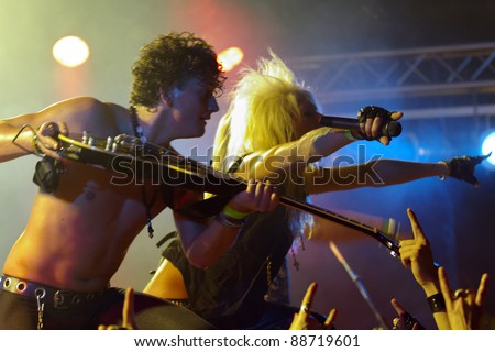 LUDWIGSBURG, GERMANY - NOVEMBER 6: Member of the rock group KISSIN DYNAMITE performs in concert at Swabia Rocks Festival Ludwigsburg on November 6, 2011 in Stuttgart, Germany - stock photo