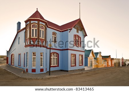 Luederitz, Namibia, Africa. Row of houses in colonial-style, built at the time when Namibia a colony of Germany (German South West Africa) was. - stock photo