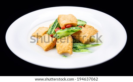 Luffa boiled tofu, Chinese traditional cuisine isolated on black background  - stock photo