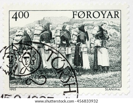 LUGA, RUSSIA - JUNE 25, 2016: A stamp printed by FAROE ISLANDS shows dairymaids carrying buckets, circa 1995.