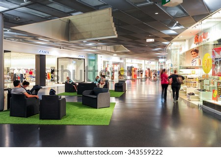 Lugano, Switzerland - 17 july 2014: people shopping on walking on the stores of the mall at Lugano on Switzerland