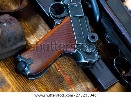 Luger Parabellum pistol and submachine gun MP 38 in gunsmith on table in a gunsmith - stock photo