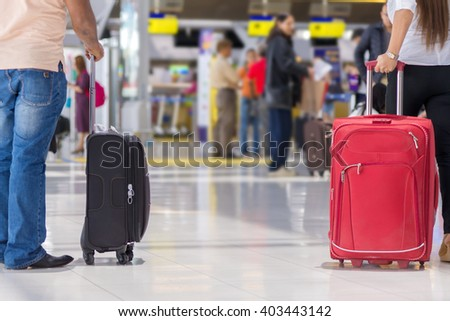 luggage at the airport terminal. - stock photo