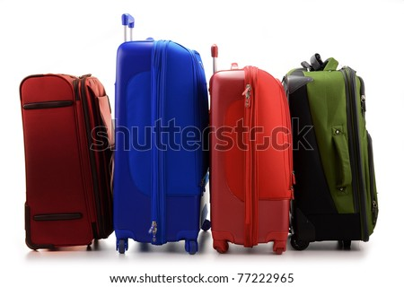 Luggage consisting of four large suitcases isolated on white - stock photo