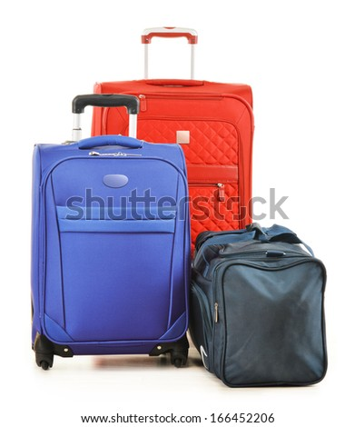 Luggage consisting of large suitcases and travel bag isolated on white - stock photo
