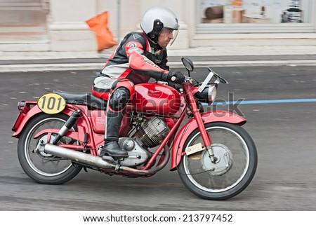 "LUGO, RA, ITALY - SEPTEMBER 30: biker riding a vintage italian motorbike Moto Guzzi Lodola Gran Turismo at motorcycle rally ""Rombi di passione"" on september 30, 2012 in Lugo, RA, Italy  - stock photo"