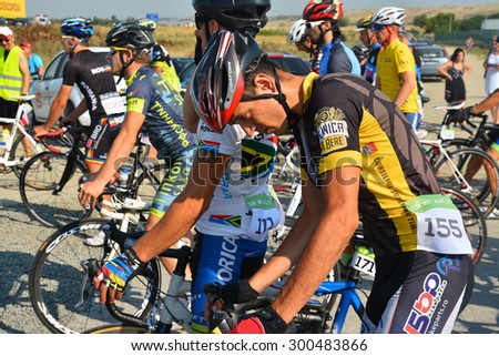 Lugoj,Romania - July 25, 2015: Portrait of a cyclist before the start of the competition Max Ausnit cup held every year in Lugoj, Romania. Shot taken on July 25th, 2015 - stock photo