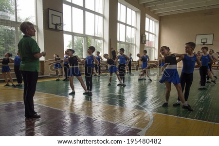 "LUHANSK, UKRAINE - May 28, 2014: Secondary students rehearsing Waltz -- Folk Dance Ensemble ""Barvinok"" is well known outside of Ukraine."