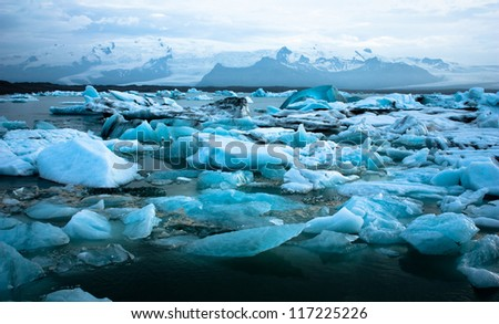 Luminous blue icebergs floating in Jokulsarlon glacial lagoon, Iceland - stock photo