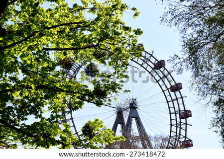 Luminous Foliage in front of a Giant Wheel - stock photo