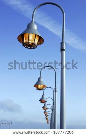 luminous street lamp against the dark sky - stock photo