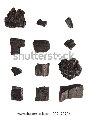 Lump of charcoal over white background - stock photo