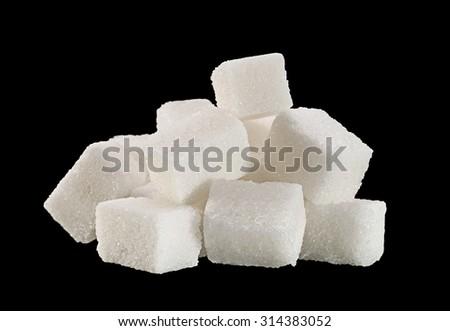 lump sugar cube isolated on black background - stock photo
