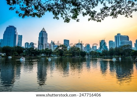 Lumphini park Bangkok downtown city in evening, Thailand - stock photo