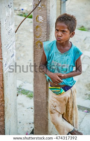 Lumpini ,Nepal . 25- July -2016. An unidentified beggar boy beg for money from tourist . Poverty is a major issue in Border India-Nepal.