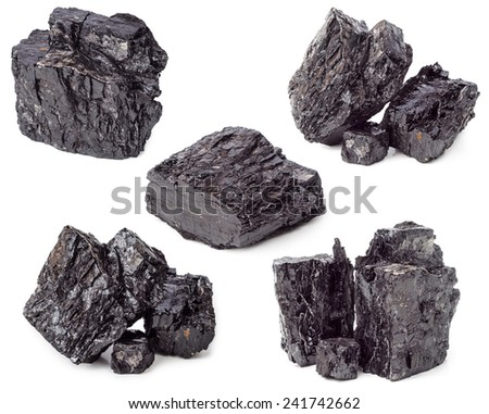 Lumps of charcoal isolated on white background - stock photo
