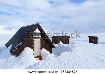 Lunch and emergency shelter on the famous Kungsleden hiking trail in Sweden. - stock photo