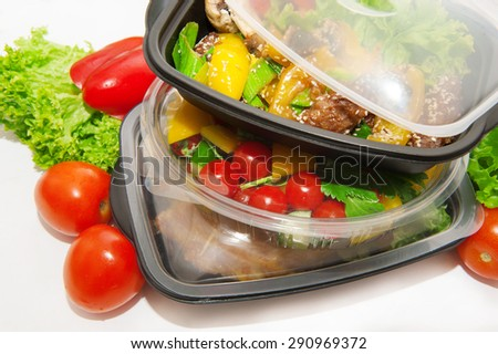 Lunch box with Chinese food and vegetables - stock photo