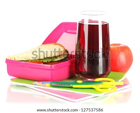 Lunch box with sandwich,apple,juice and stationery isolated on white - stock photo