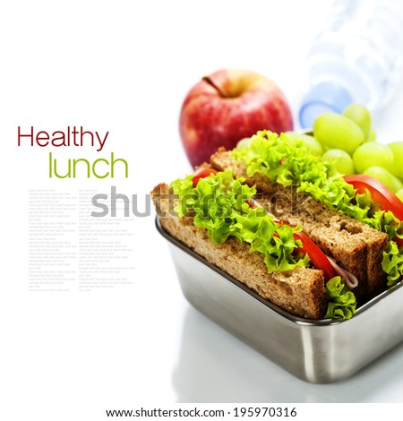Lunch box with sandwiches, fruits  and water on white background - stock photo